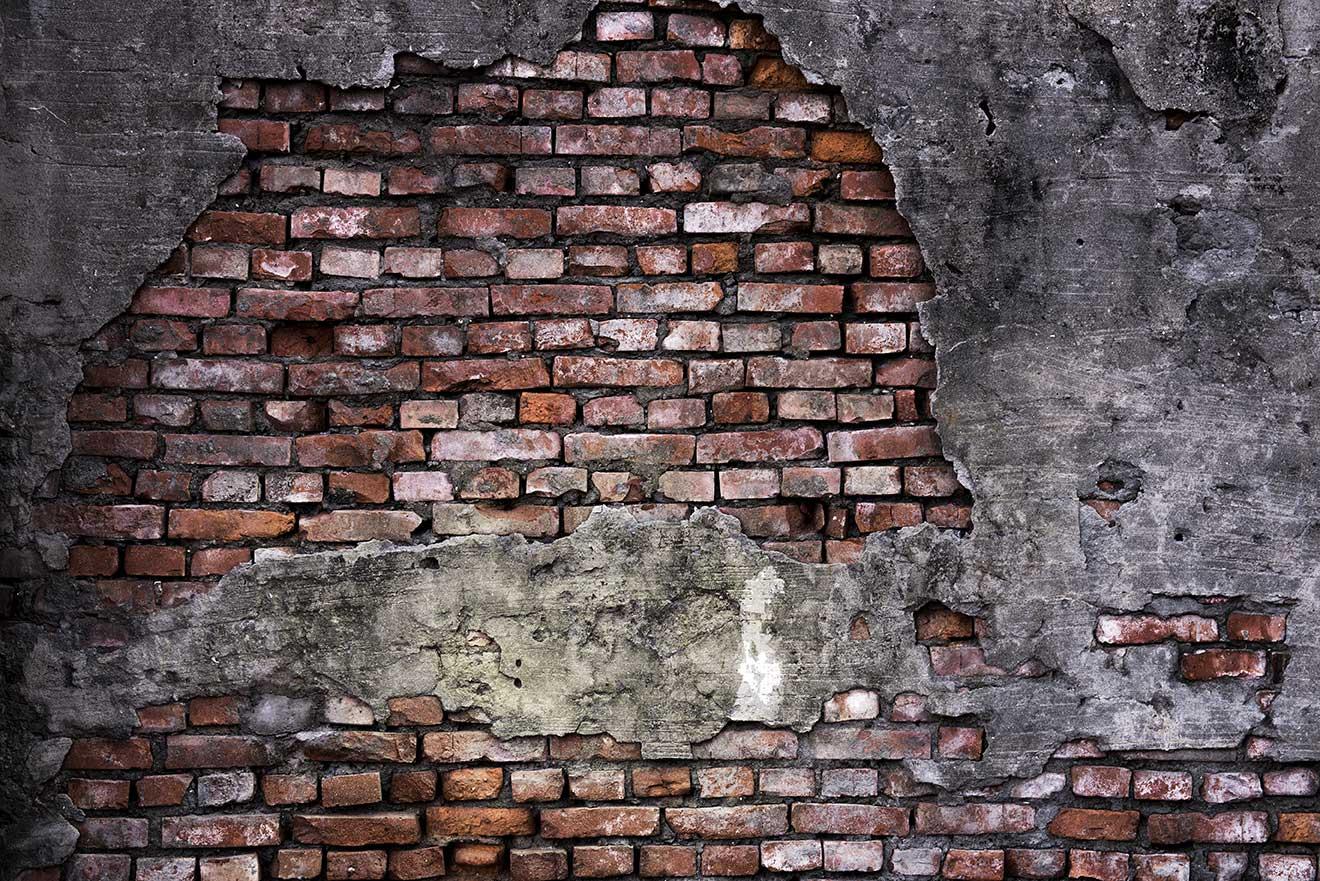Fotobehang kapotte bakstenen muur de fabriek muurstickers for Industriele muur